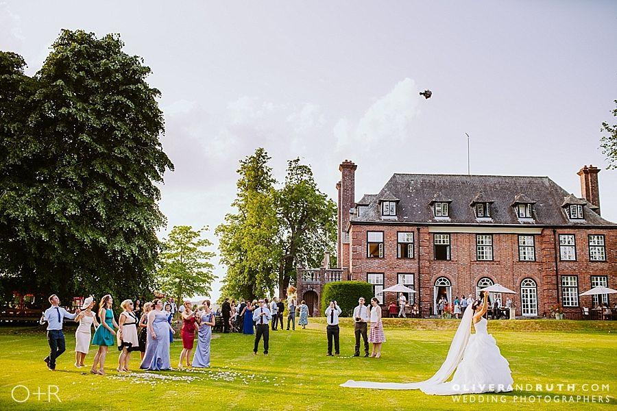 Bouquet toss at Llansantffraed Court