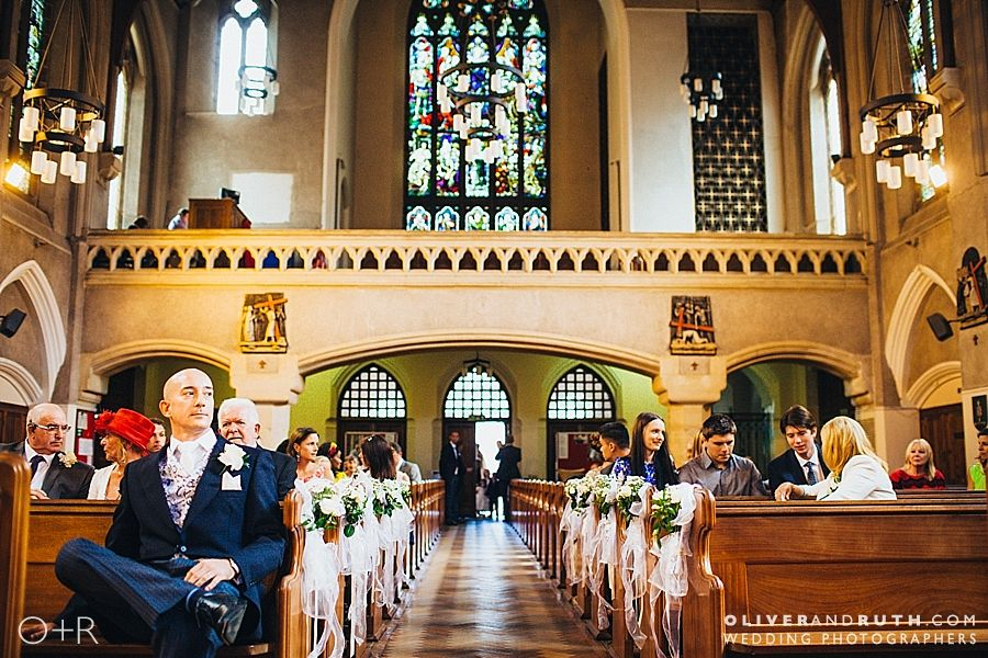 Groom waiting in Cardiff Cathedral of St. David