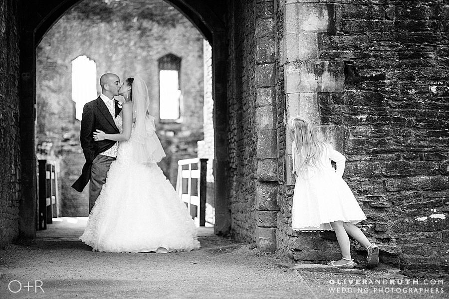 Bridesmaid watches Bride and Groom at Caerphilly Castle