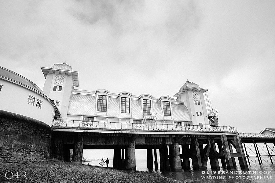 Bride and groom underneath Penarth pier