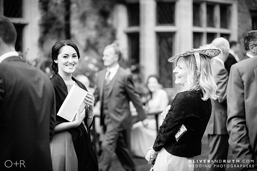 Wedding guests laughing at Miskin Manor