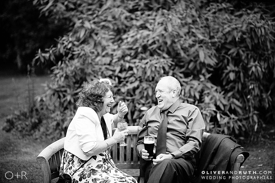 Wedding guests laughing at Pencoed House