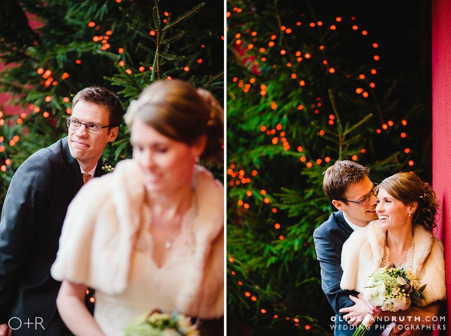 Bride and groom with Christmas lights at a Cawdor wedding