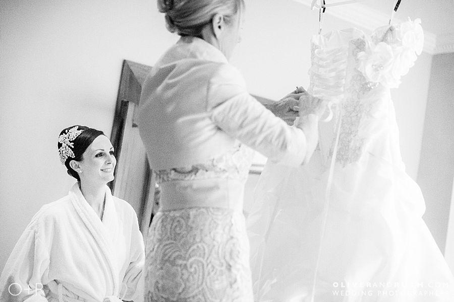 Bride looking at wedding dress at Miskin Manor