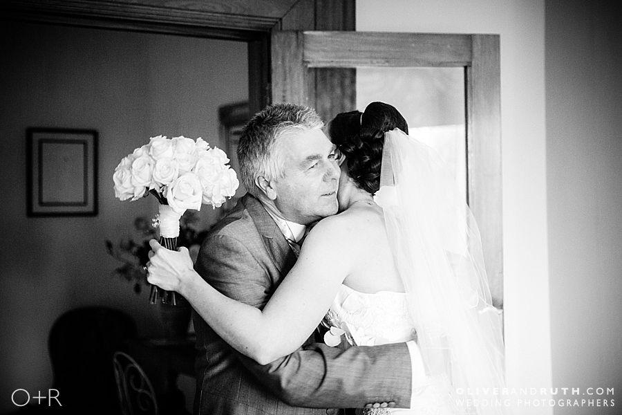 Bride hugs Dad at Miskin Manor wedding