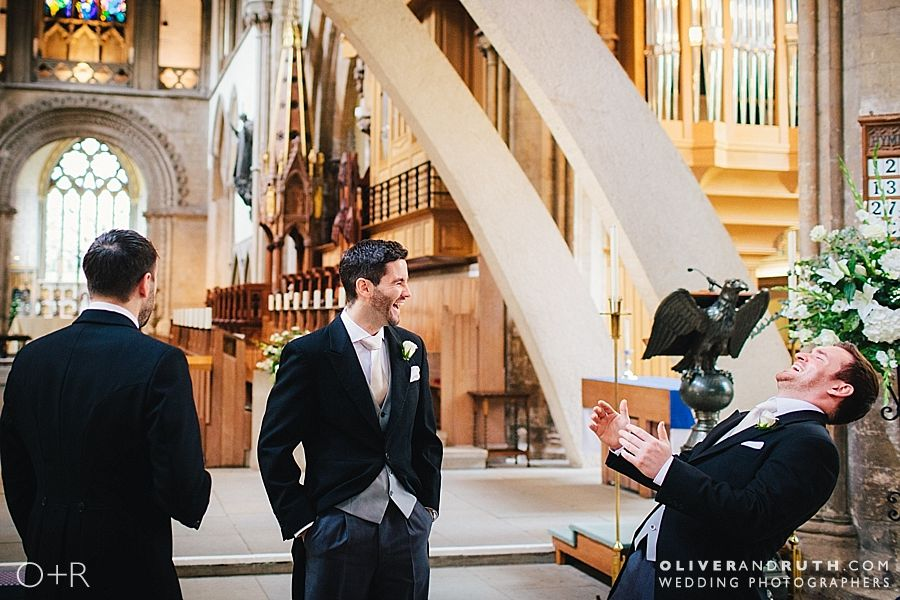Groom waits for bride at Llandaff Cathedral