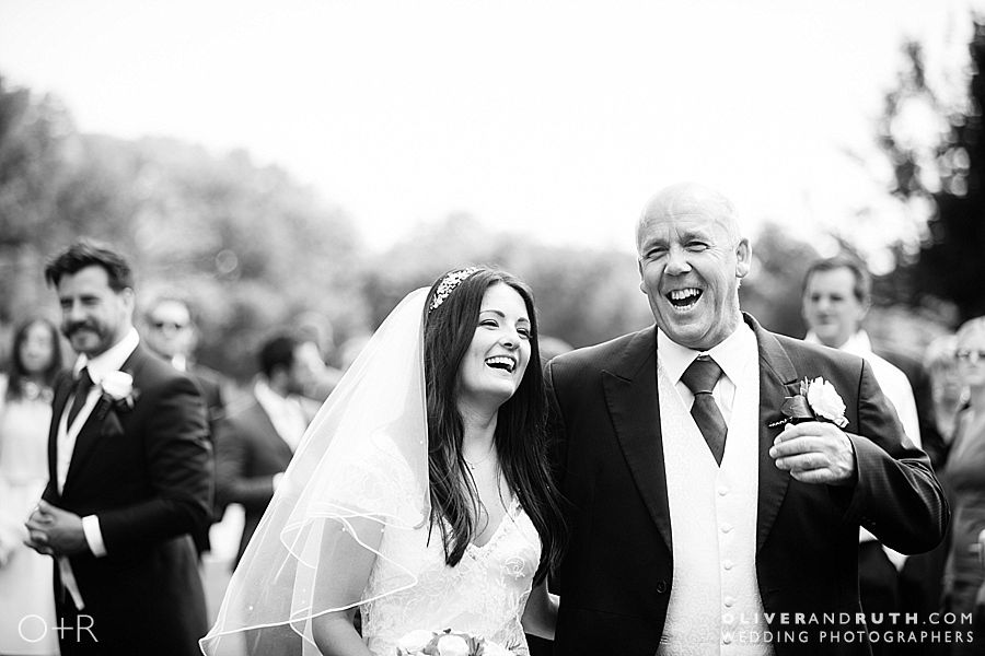 Bride & dad laughing at Canada Lodge & Lake wedding