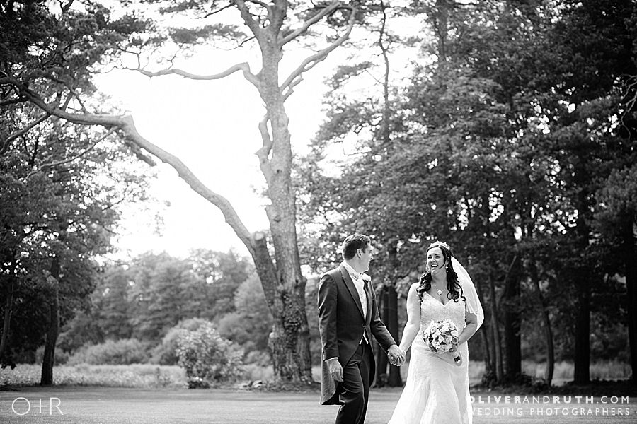 Bride & groom walking at Hensol Castle