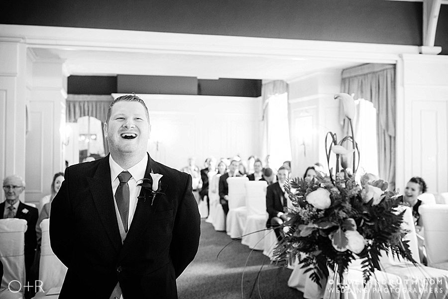Groom waits for bride at Coed-Y-Mwstwr wedding ceremony