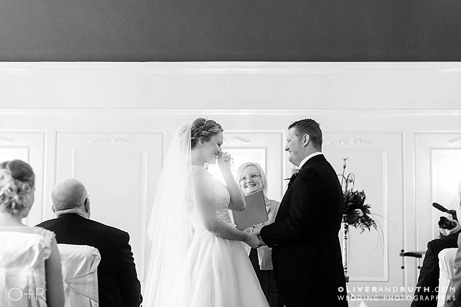 Emotional bride during Coed-Y-Mwstwr wedding ceremony