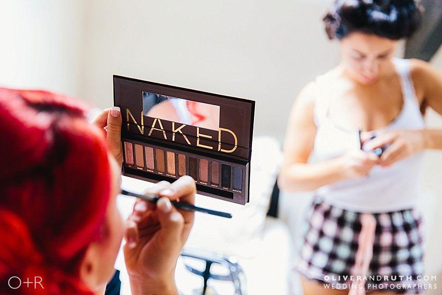 Bridesmaid applying Naked make up before the wedding at Pencoed House