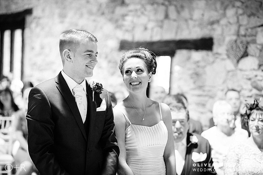 Bride looking at groom during their wedding ceremony at Pencoed House