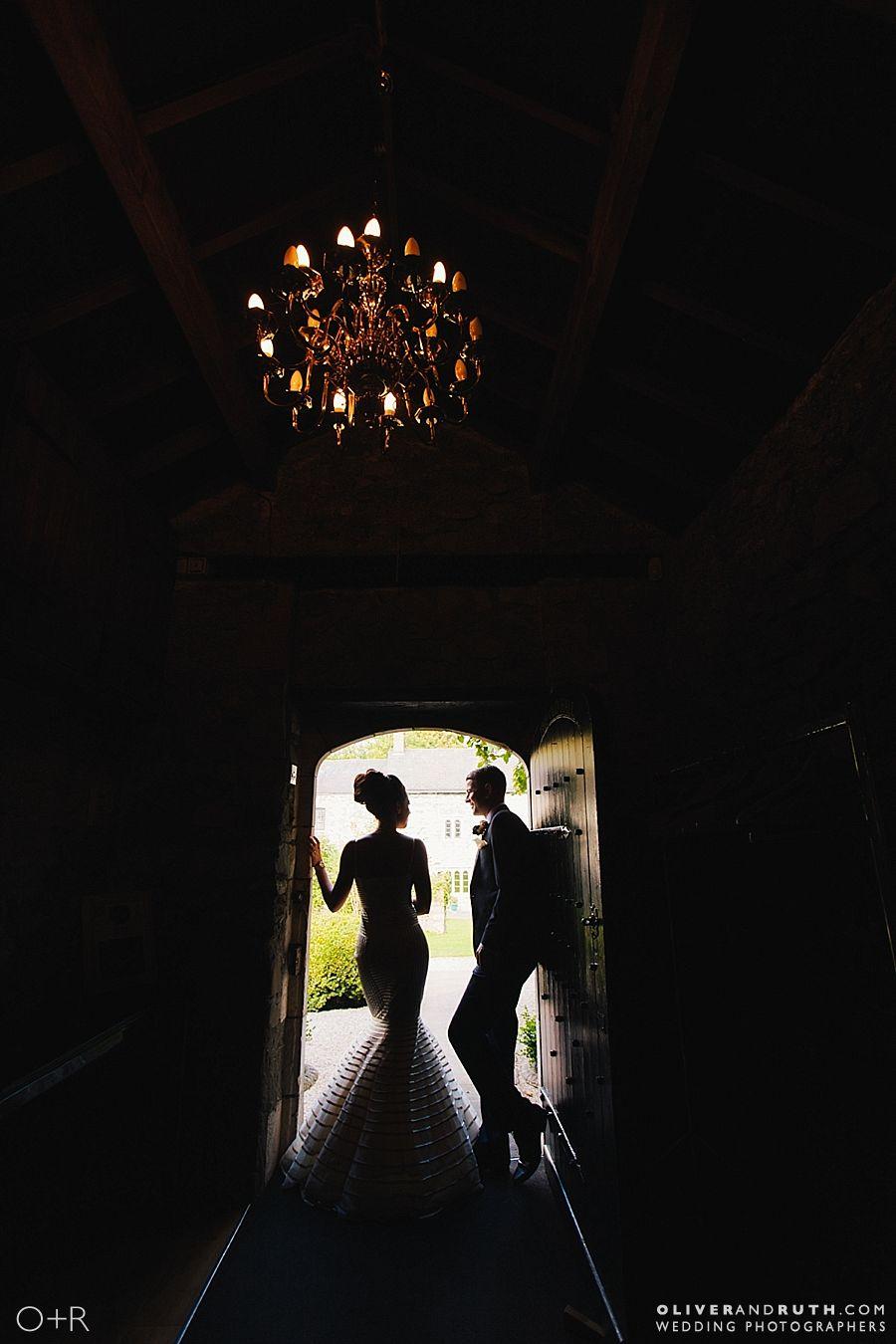 Bride and groom wedding silhouette in doorway at Pencoed House