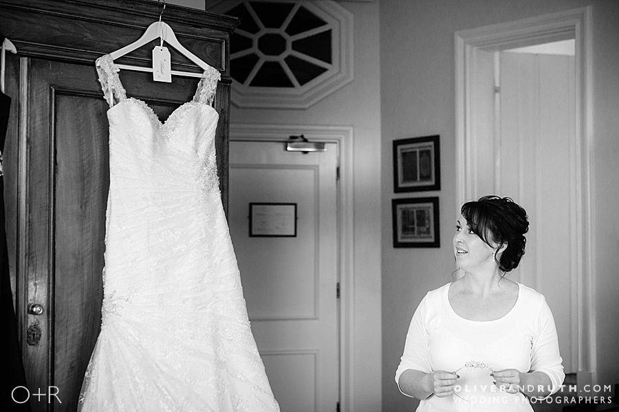 Bride looks at wedding dress at Llangoed Hall