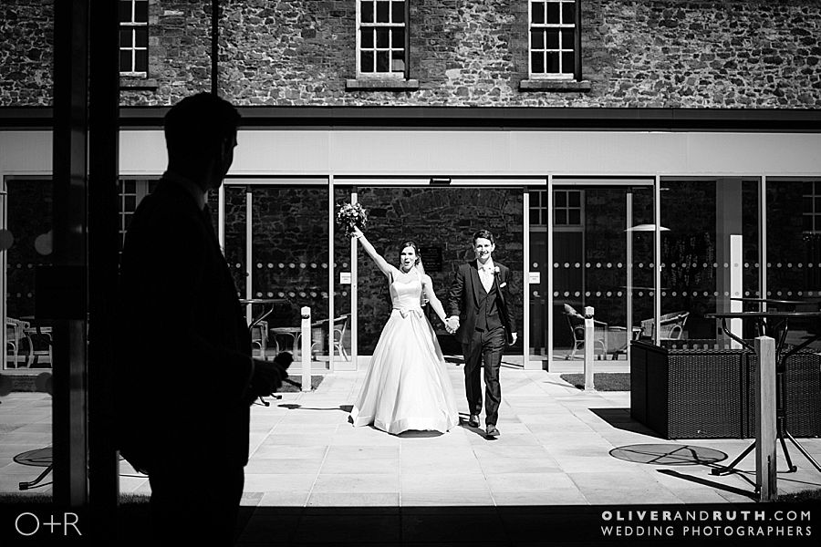 Bride and groom's entrance into Hensol castle wedding breakfast