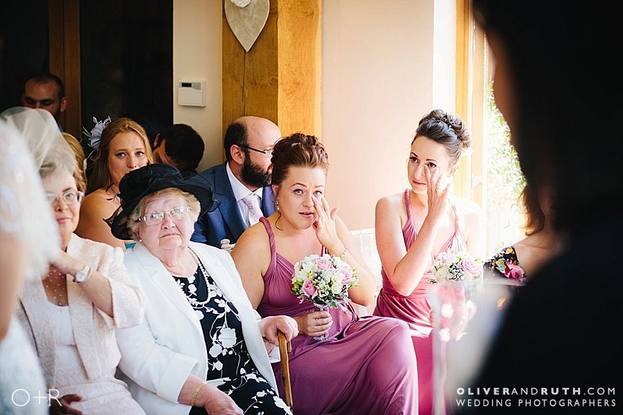 Emotional bridesmaids during wedding ceremony at Oldwalls