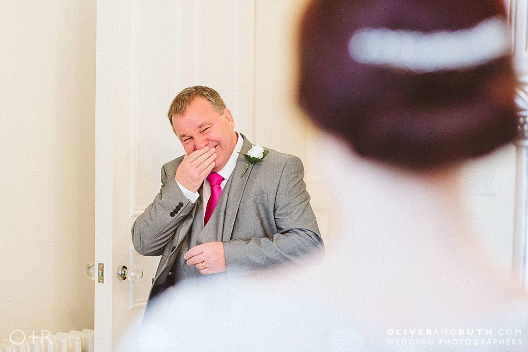 Emotional Dad in the bridal suite at Manor By The Lake, Gloucestershire