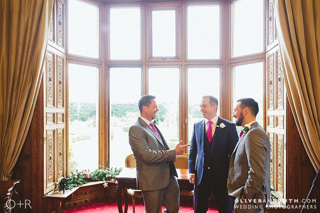 Groom and best men in the wedding ceremony room at Manor By The Lake