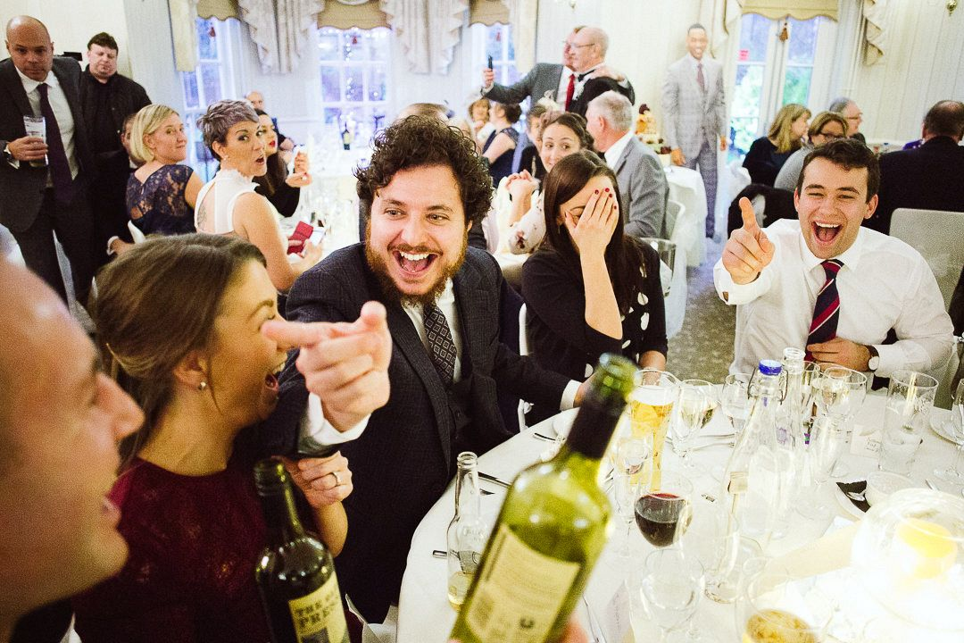 Wedding guests having fun at De Courceys Manor, Cardiff
