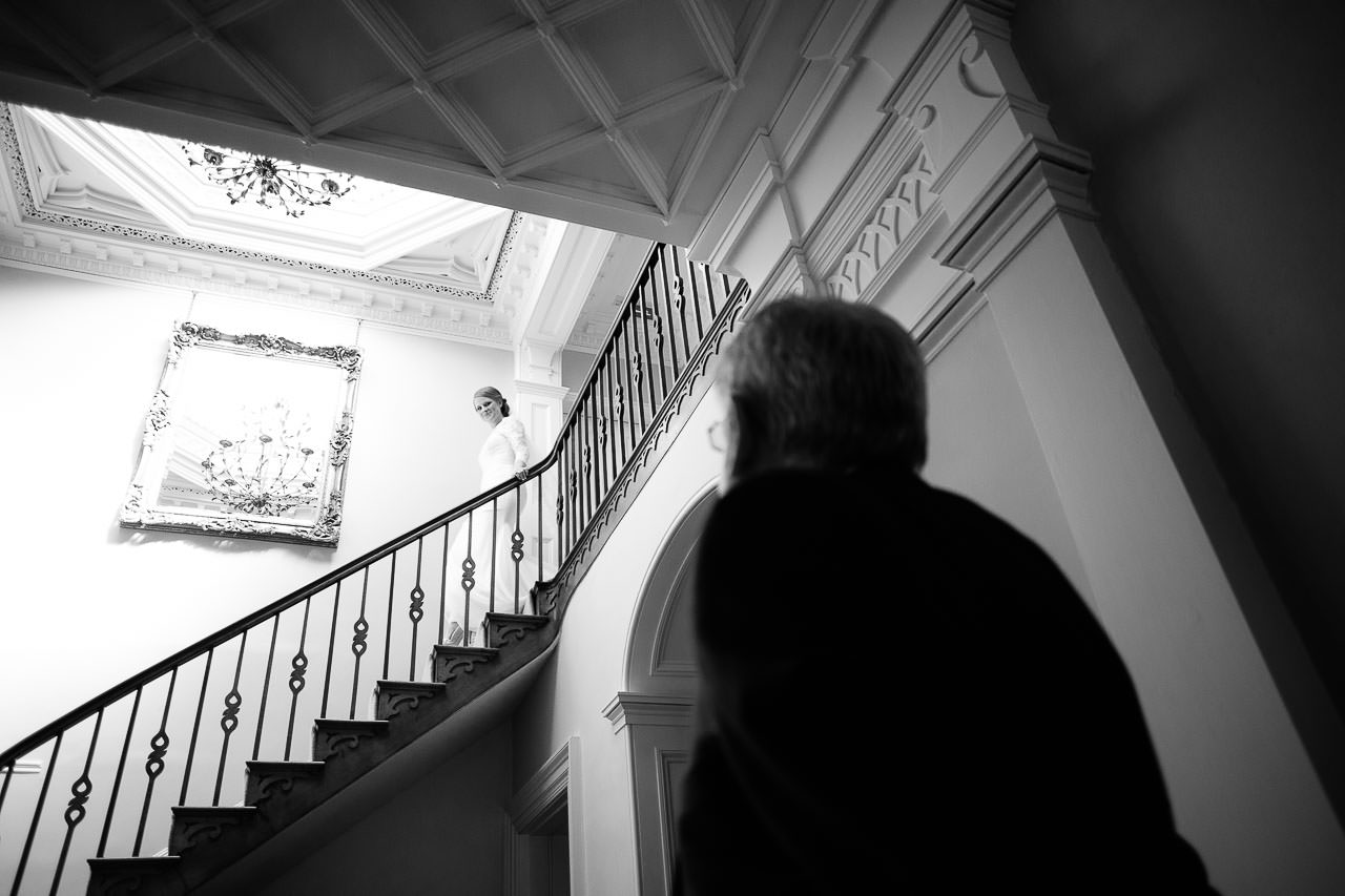 Bride on staircase at Felin Newydd House
