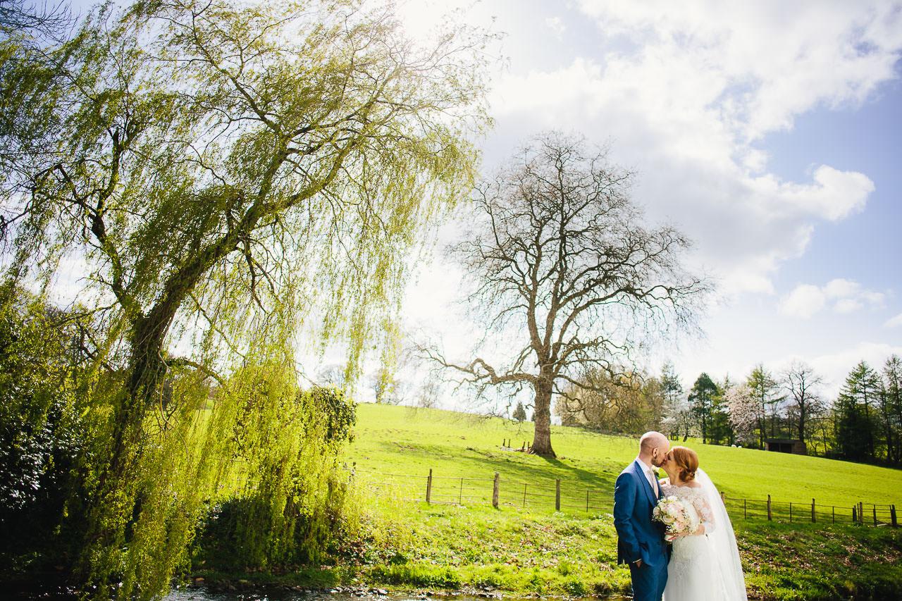 Bride and groom kissing at Felin Newydd House wedding