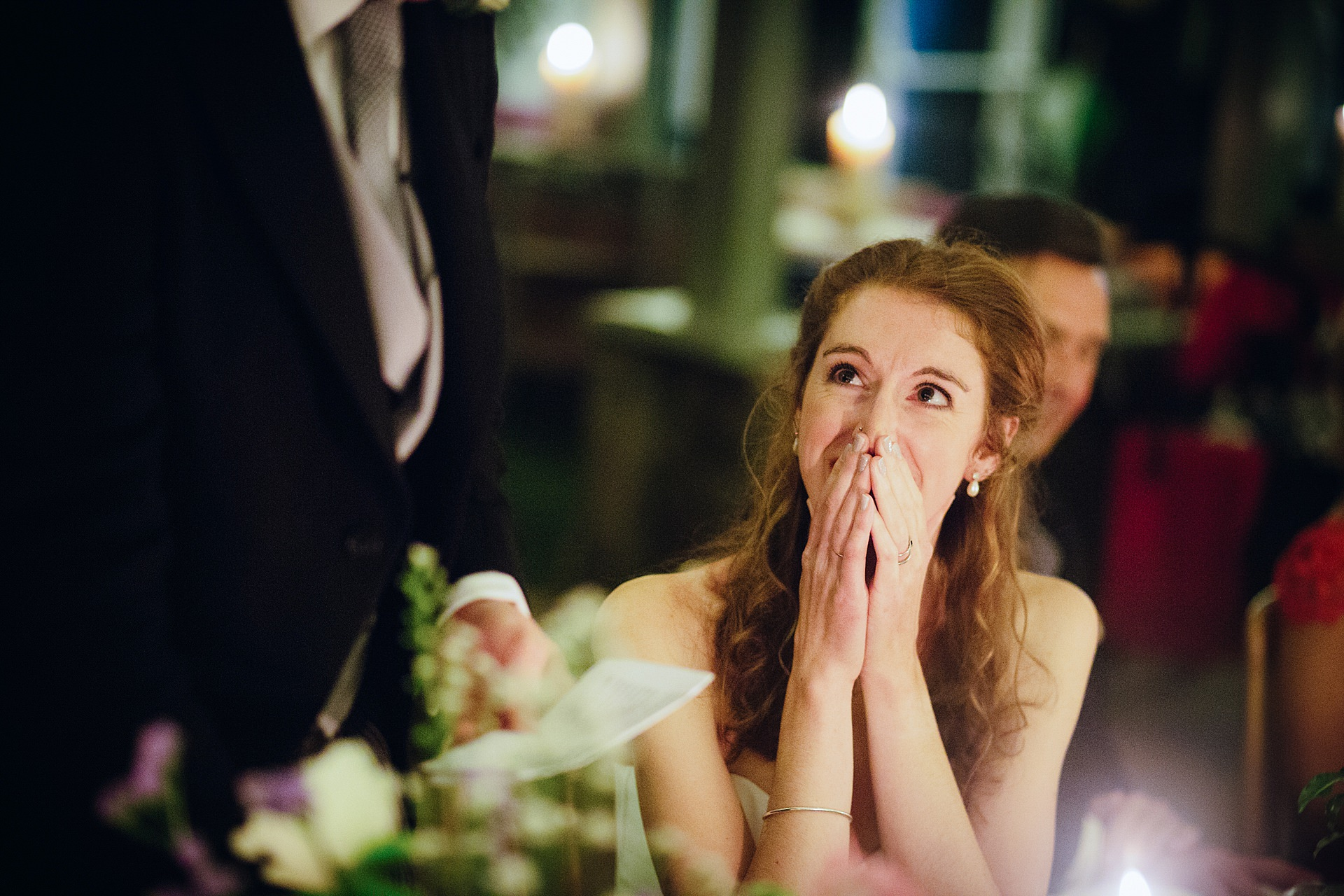 Bride looks lovingly at her groom during his wedding speech